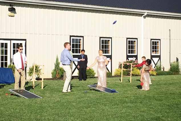 Image of people outdoors enjoying lawn games