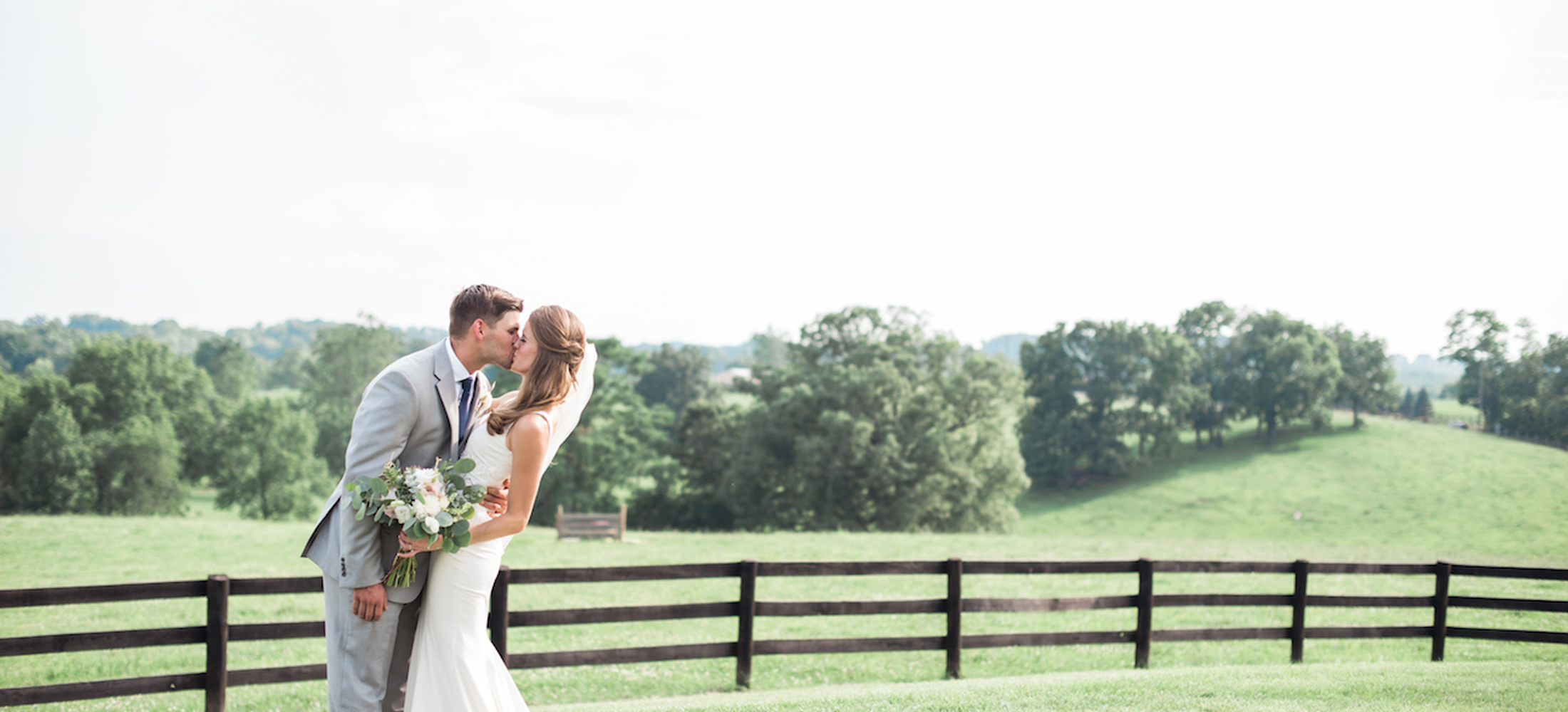 Image of a bride and groom kissing outside Shadow Creek in Loudoun County Virginia