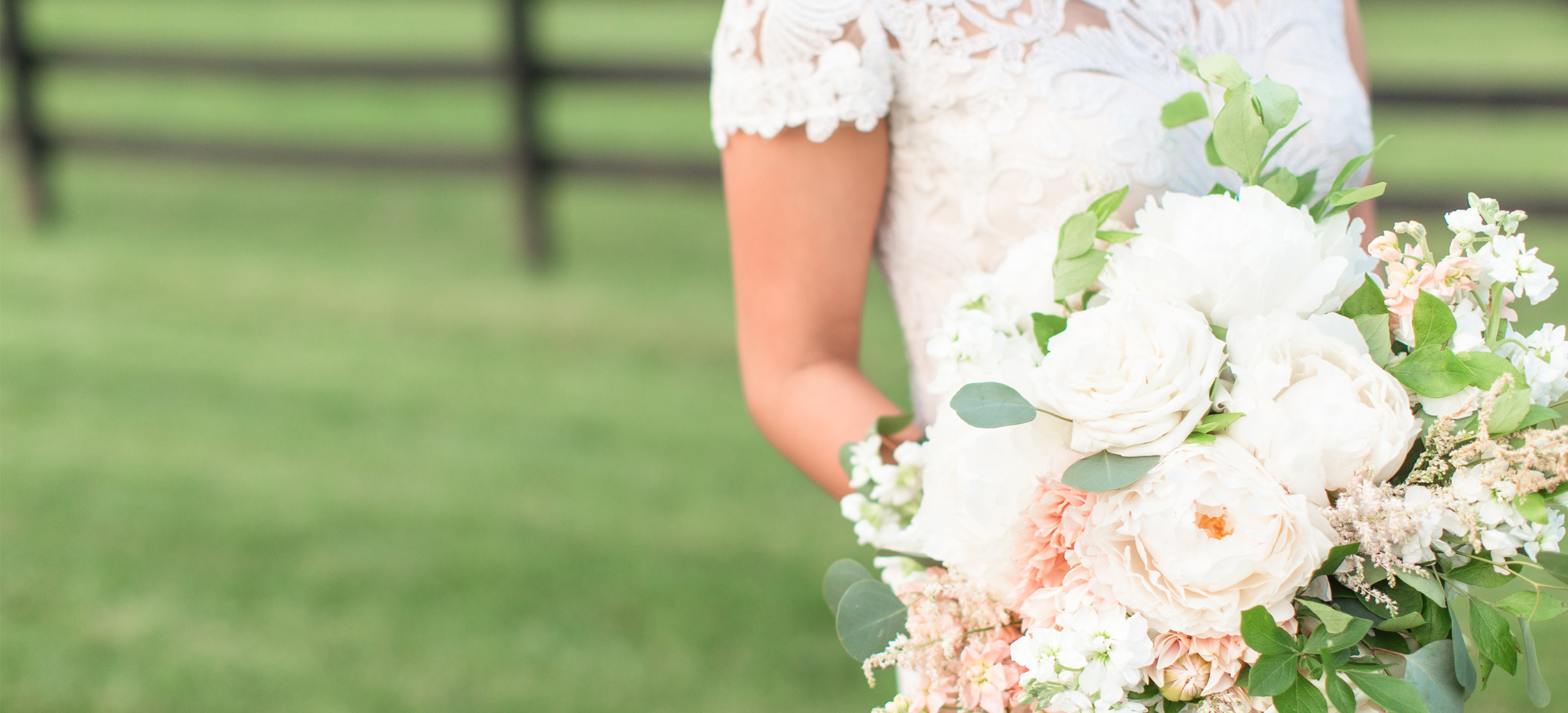 Image of a bride holding a beautiful white and peach bouquet for her wedding