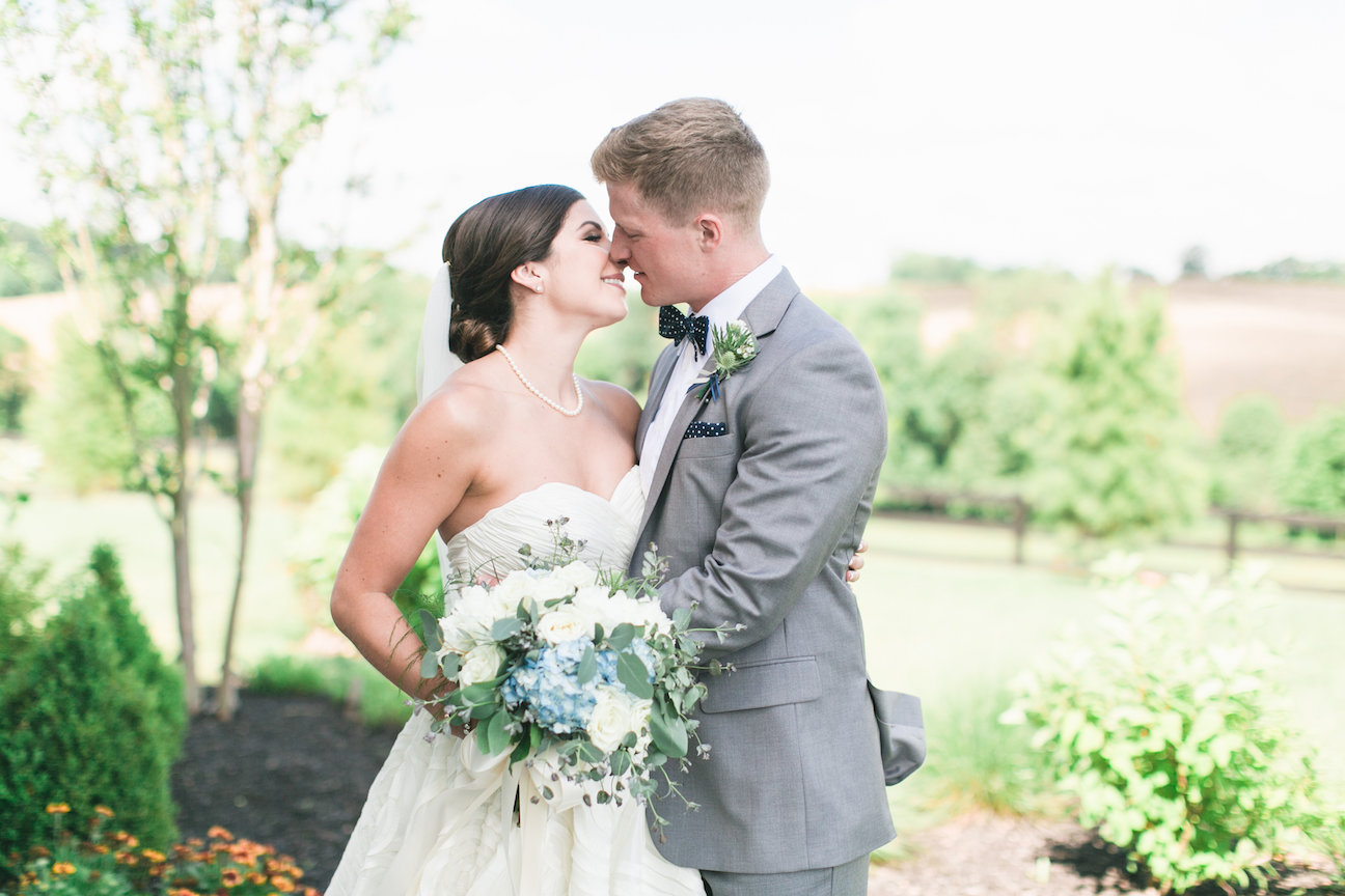 Happy bride and groom kissing on their wedding day at Shadow Creek in Virginia