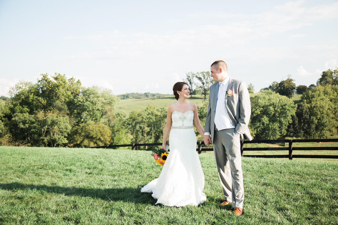 Bride and Groom pose for farm picture at Shadow Creek in Virginia