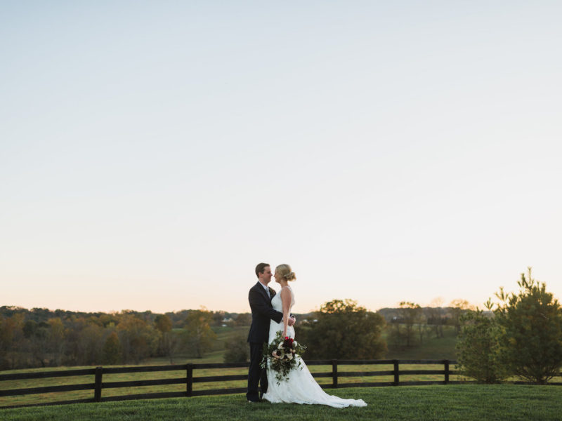 A bride and groom pose for a sunset picture at Shadow Creek Barn in Virginia