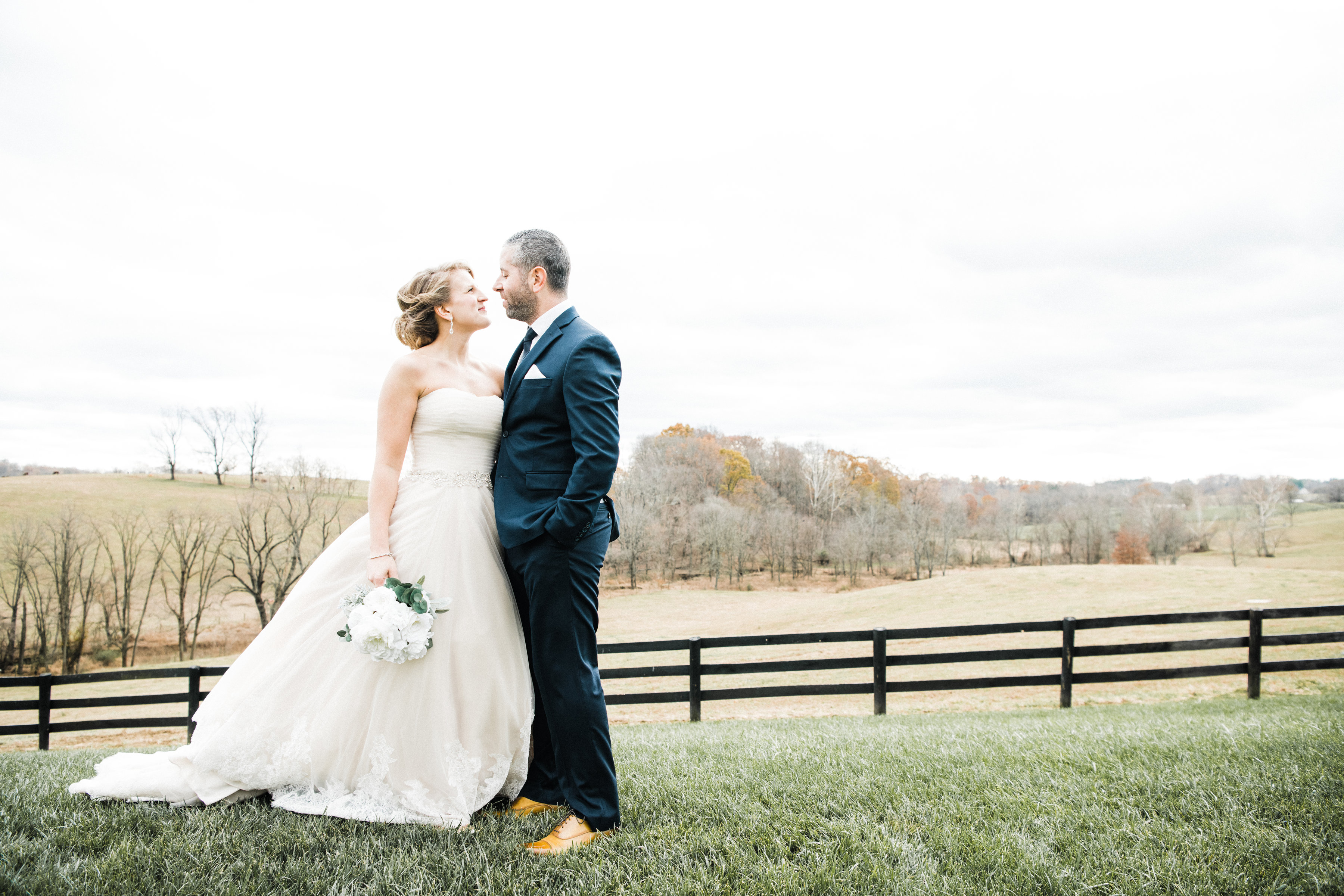 bride and groom pose for a wedding pictures in Loudoun County