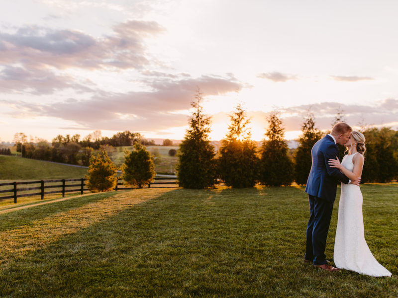 Bride and groom kiss at their sunset wedding at Shadow Creek