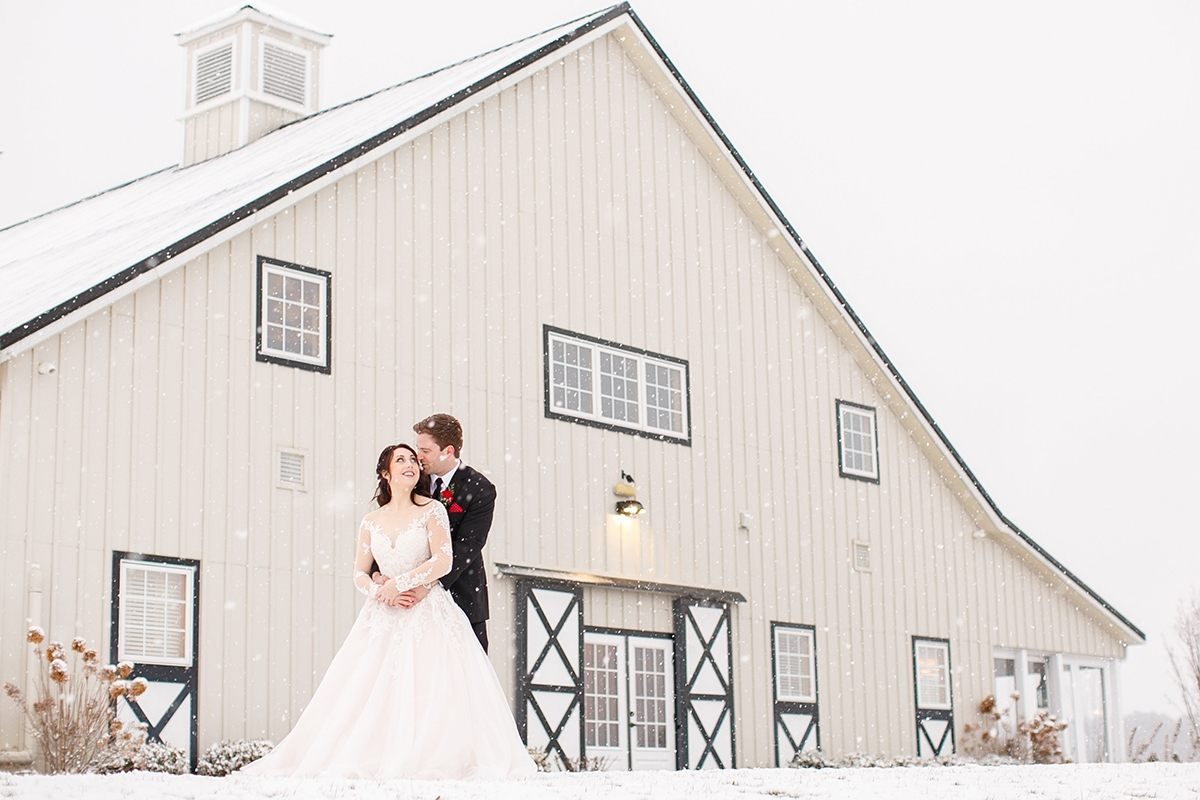 snowy wedding day with bride and groom at shadow creek barn in virginia