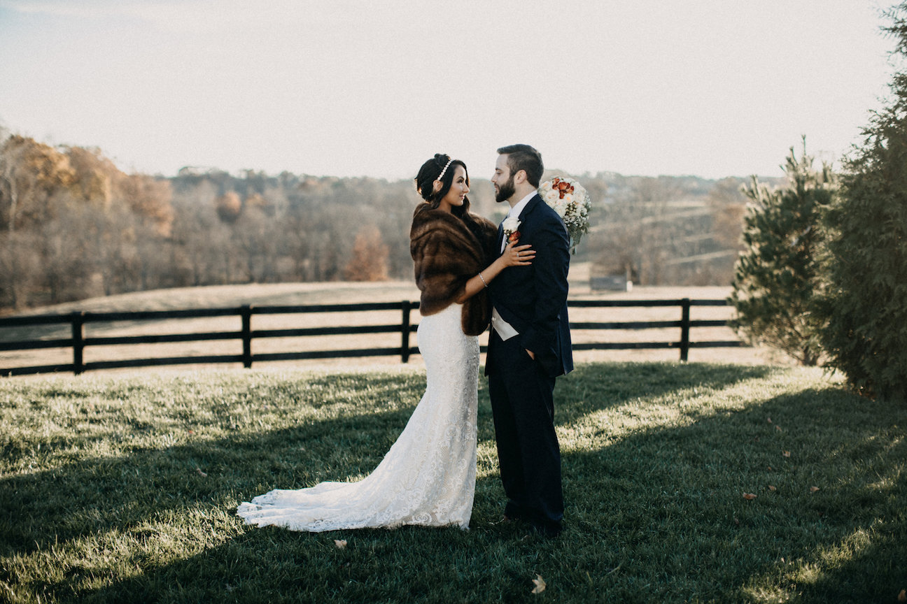 Bride and groom pose for a picture during sunset at Shadow Creek a Virginia Barn wedding venue