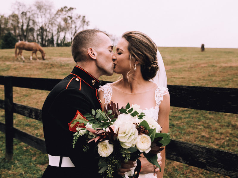 Bride and groom take a picture in the pasture at a Virginia barn wedding venue