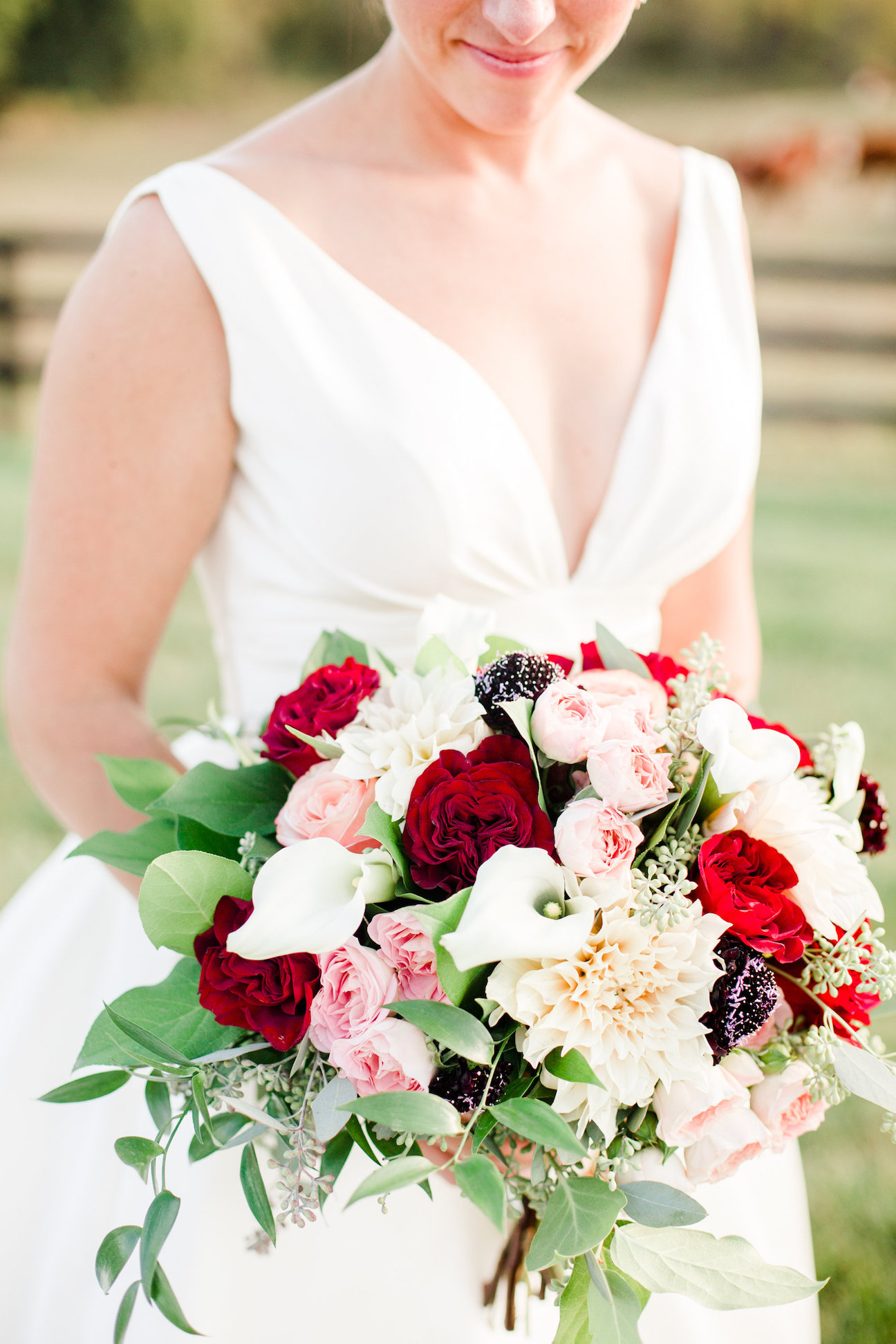 bridal bouquet with red and pink flowers