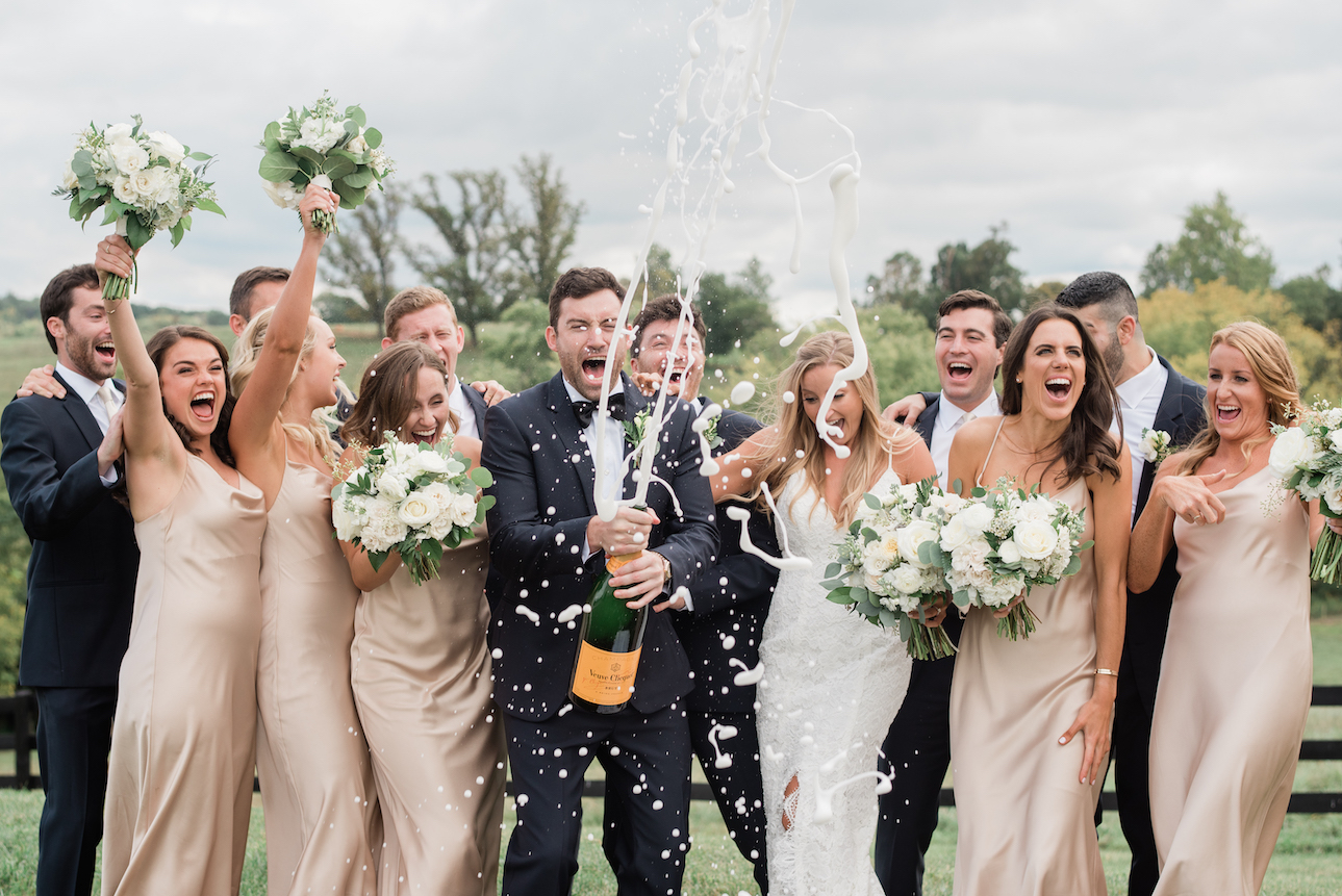 champagne opening with bridal party